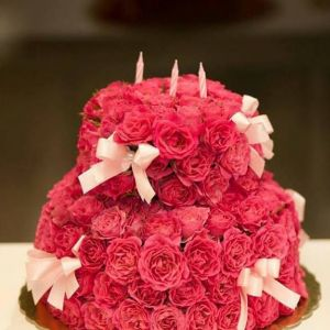 Fuschia flower cake with bows