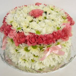 White flower cake with pink details